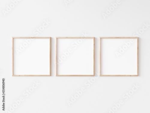 Fototapeta Three square thin wooden frame on white wall. 3d illustration. obraz