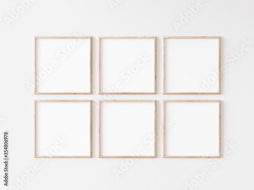 Fototapeta Six square thin wooden frame on white wall. 3d illustration.