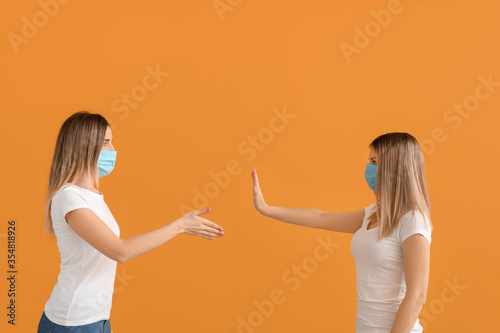 Fototapeta Woman refusing to shake hands against color background