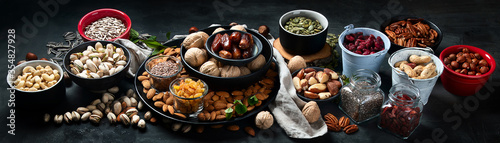 Different types of nuts, seeds and dried fruits Wallpaper Mural