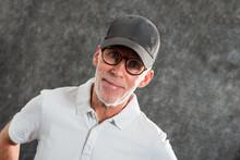 Sixty Year Old Man Wearing A Baseball Cap