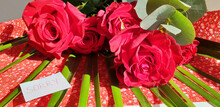 """A Bouquet Of Red Roses With A Note """" Sorry """"on The Table. The Concept Of Apology."""