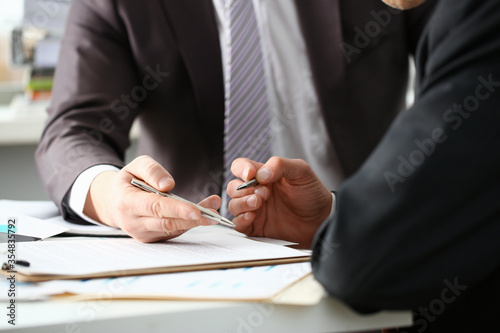 Male arm in suit and tie fill form clipped pad with silver pen closeup Canvas Print