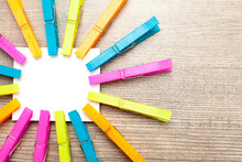 Colorful Clothes Pins Hold Whi...