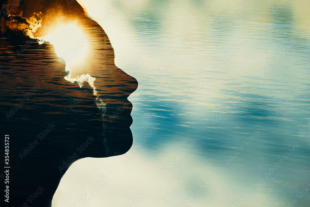 Fototapeta Woman silhouette with sun in head with copy space. Multiple exposure image.
