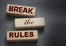 Break The Rules Phrase On Wood...