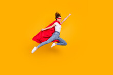 Full Length Body Size View Of Her She Nice Attractive Strong Motivated Energetic Fit Slim Cheerful Girl Jumping Wearing Cape Rescuing Earth Isolated Bright Vivid Shine Vibrant Yellow Color Background