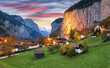 Dramatic autumn view of Lauterbrunnen valley with gorgeous Staubbach waterfall and Swiss Alps at sunset time