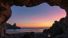 Sunset In Cave Over The Sea
