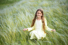 Girl In A Field. Young Woman I...