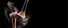 Make Up Cosmetic Brushes With Powder Blush Explosion On Black Background. Skin Care Or Fashion Concept. Free Space For Your Text