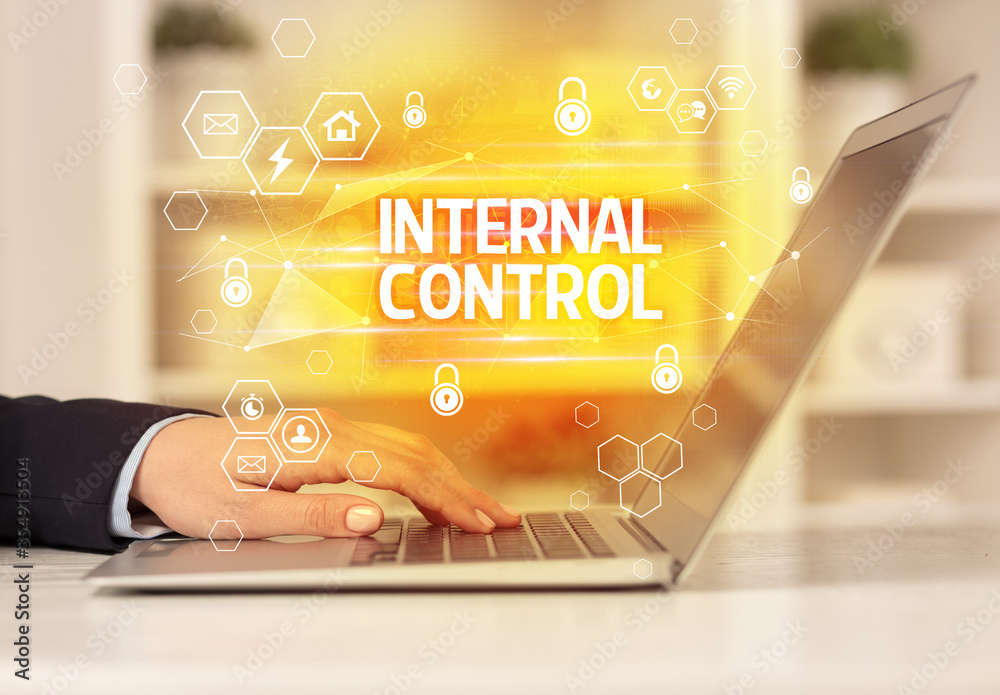 Fototapeta INTERNAL CONTROL inscription on laptop, internet security and data protection concept, blockchain and cybersecurity