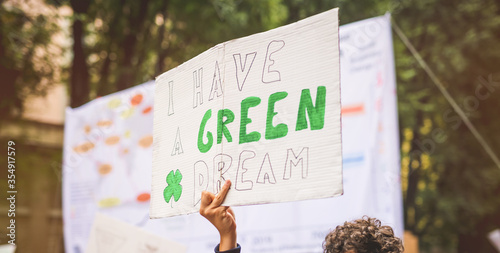 Fotomural People holding picket signs  I have a green dream climing for climate change i