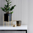 Stylish decorations on white console table, close-up