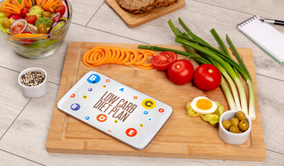 Healthy Tablet Pc compostion with LOW CARB DIET PLAN inscription, weight loss concept