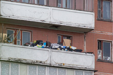 Balcony In The Apartment Of People Who Suffers From Compulsive Hoarding, Littered With Trash And Other Items