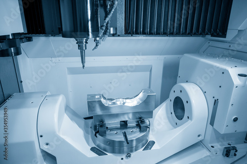 Obraz na plátně The 5 axis CNC machining center cutting the automotive mold parts with solid ball endmill tools