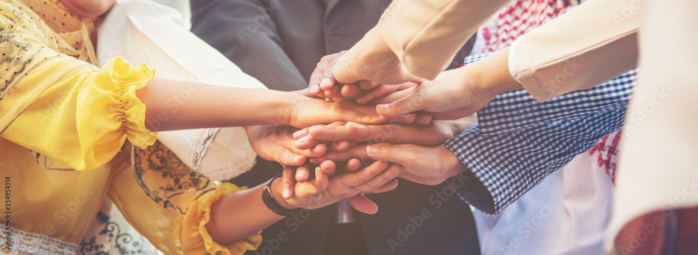 Fototapeta Group of people diversity multiethnic teamwork collaboration team meeting communication  Unified team concept. Business people hands together diversity multiethnic diverse culture partner team meeting