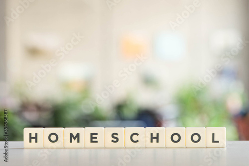 Valokuva white blocks with homeschool lettering on white desk