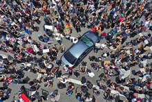Protestors Gathered At A Cross...