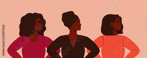 Fotografia Three strong African women stand together