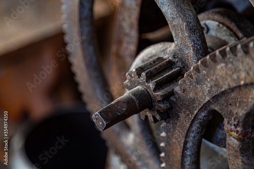 Fototapeta Gears in an old and rusty gear reductor trasmission with soft focus