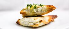 Handmade Greek Spinach And Feta Cheese Phyllo Spanakopita On White Plate