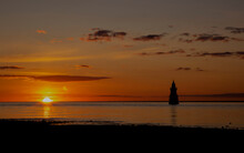 Plover Scar Lighthouse In Lancashire Silhouette At Sunset