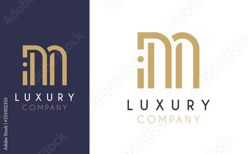 Fototapeta Premium Vector M Logo in two colour variations. Beautiful Logotype design for luxury company branding. Elegant identity design in blue and gold. obraz