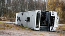 Broken After Accident Bus On Its Side.