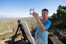 Senior Woman Artist Painting L...