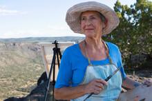 Senior Woman Artist Painting Landscape, White Rock, New Mexico