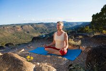 Senior Woman Practicing Yoga O...