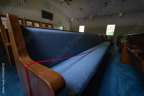 Church phew marked off with red ribbon for worship due to Coronavirus Fototapet