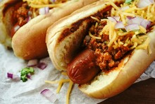 Homemade Chili Dogs Topped Wit...