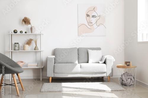 Fototapeta Interior of modern room with shelf unit obraz