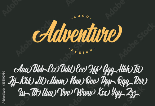 Tablou Canvas Adventure script font design. Vector alphabet.