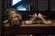Bridal Shoes On A Piano With Flowers