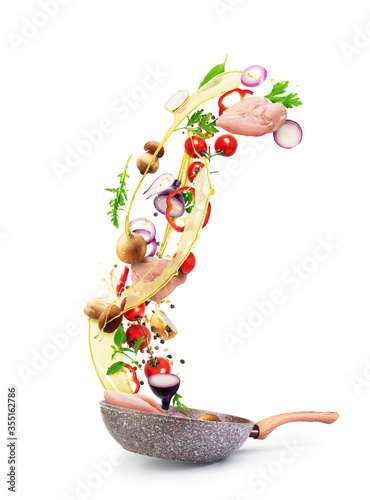 Obraz Cooking concept. Vegetables and bacon are falling on a pan isolated on white background. Healthy food. - fototapety do salonu