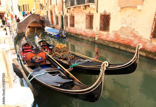 Fototapeta Gondolas in a small canal in Venice, Italy. obraz