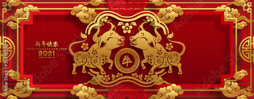 Photo Chinese new year 2021 year of the ox , red paper cut ox character,flower and asian elements with craft style on background