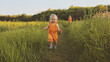 Toddler girl walking outdoor with mother family vacations child traveling eco tourism happy smiling emotions summer season nature