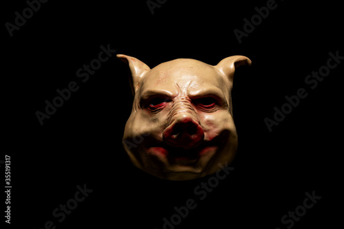Scary pig mask isolated on black background Canvas Print