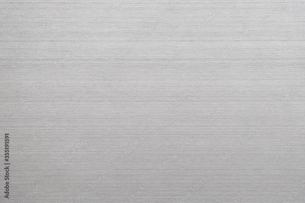 Fototapeta Abstract metal texture of brushed stainless steel plate with the reflection of light.