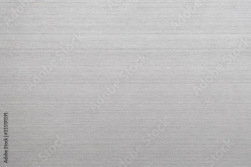 Fototapeta Abstract metal texture of brushed stainless steel plate with the reflection of light. obraz