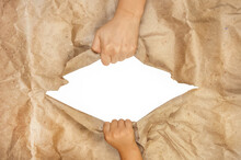 Two Hands Tear A Large Sheet O...