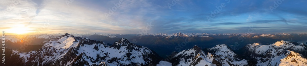 Fototapeta Aerial Panoramic View of Canadian Mountain Landscape, Tantalus Range, during a colorful sunset. Taken near Squamish, North of Vancouver, British Columbia, Canada. Nature Background Panorama
