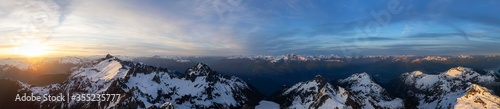 Fototapeta Aerial Panoramic View of Canadian Mountain Landscape, Tantalus Range, during a colorful sunset. Taken near Squamish, North of Vancouver, British Columbia, Canada. Nature Background Panorama obraz