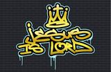 Fototapeta Młodzieżowe - Religious spray graffiti tag ''Jesus is Lord'' with stylized crown. Hand lettering typography. Black brick wall background.
