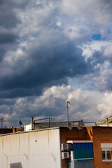Clouds over suburbs building